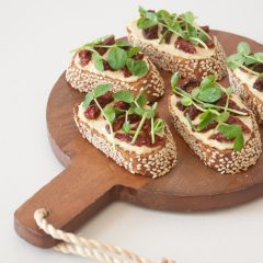 Hummus, Sun-Dried Tomato, and Pea Shoot Crostini